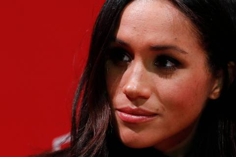 (FILES) In this file photo taken on December 01, 2017 Britain's Prince Harry's fiancee US actress Meghan Markle gestures as they tour the Terrence Higgins Trust World AIDS Day charity fair at Nottingham Contemporary in Nottingham, central England, on December 1, 2017. - Meghan Markle has revealed she suffered a miscarriage in July this year, writing in the New York Times on November 25, 2020 of the deep grief and loss she endured with her husband Prince Harry. (Photo by Adrian DENNIS / various sources / AFP)