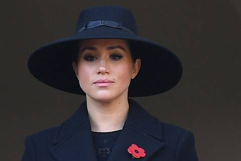 (FILES) In this file photo taken on November 10, 2019 Britain's Meghan, Duchess of Sussex looks on from a balcony as she attends the Remembrance Sunday ceremony at the Cenotaph on Whitehall in central London, on November 10, 2019. - Meghan Markle has revealed she suffered a miscarriage in July this year, writing in the New York Times on November 25, 2020 of the deep grief and loss she endured with her husband Prince Harry. (Photo by Daniel LEAL-OLIVAS / AFP)