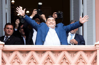 Argentinian soccer legend Diego Armando Maradona leaves after meeting Argentina's President Alberto Fernandez at the Casa Rosada Presidential Palace, in Buenos Aires