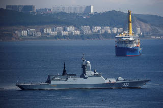 FILE PHOTO: The Russian navy corvette Sovershenny and the Gazprom owned pipe-laying ship Akademik Cherskiy are seen offshore Vladivostok
