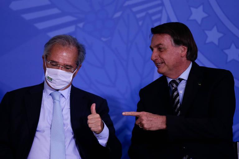 O ministro Paulo Guedes ao lado do presidente Jair Bolsonaro