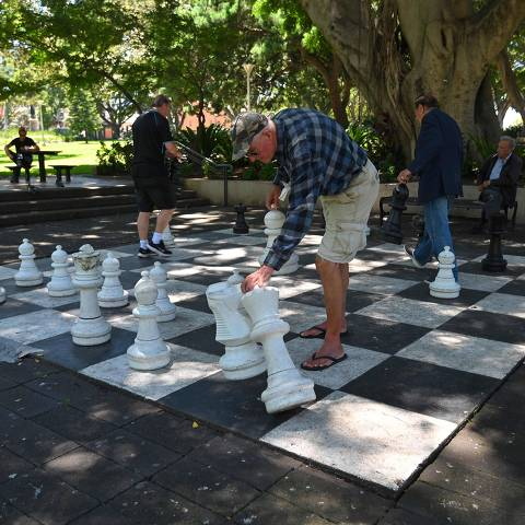 People play chess on a giant chess board at Hyde Park in Sydney on November 26, 2020. - Hit miniseries