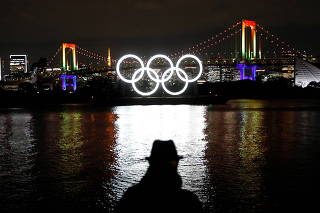 The giant Olympic rings are illuminated after being reinstalled at Odaiba Marine Park, amid the coronavirus disease (COVID 19) outbreak, in Tokyo