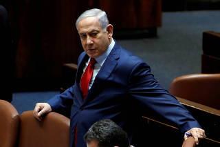 FILE PHOTO: Israeli Prime Minister Benjamin Netanyahu arrives to the plenum at the Knesset, Israel's parliament, in Jerusalem
