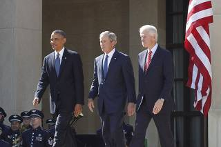 President Obama walks alongside former U.S. presidents as they attend the dedication ceremony for the George W. Bush Presidential Center in Dallas