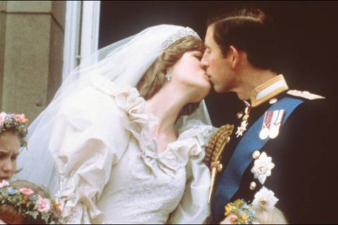 In this file photo taken on July 29, 1981 Charles, Prince of Wales, kisses his bride, Lady Diana, on the balcony of Buckingham Palace when they appeared before a huge crowd after their wedding in St Paul's Cathedral. - The fourth season of Netflix hit