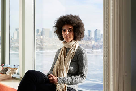 Timnit Gebru, who led a research effort based at Stanford University that analyzed 50 million images and location data from Google Street View, in Boston, Dec. 29, 2017. Artificial intelligence is making it possible for Street Views to be mined for insights about the economy, politics and human behavior ? just as text mining has done for years. ?This kind of social analysis using image data is a new tool to draw insights,? she said. (Cody O'Laughlin/The New York Times) ORG XMIT: XNYT74