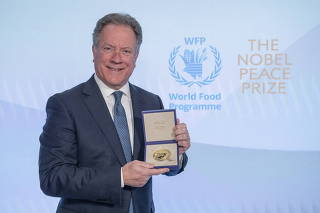 Executive Director of the UN WFP Beasley poses in Rome