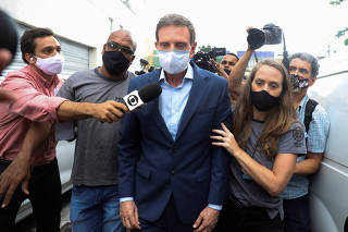 FILE PHOTO: Rio de Janeiro's Mayor Marcelo Crivella is escorted by police officers after being detained