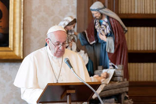 FILE PHOTO: Pope Francis leads Angelus prayer inside a library, at the Vatican