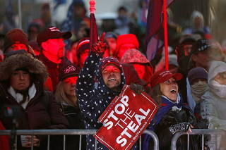 Suporters of U.S. President Donald Trump gather at a rally at Freedom Plaza in Washington