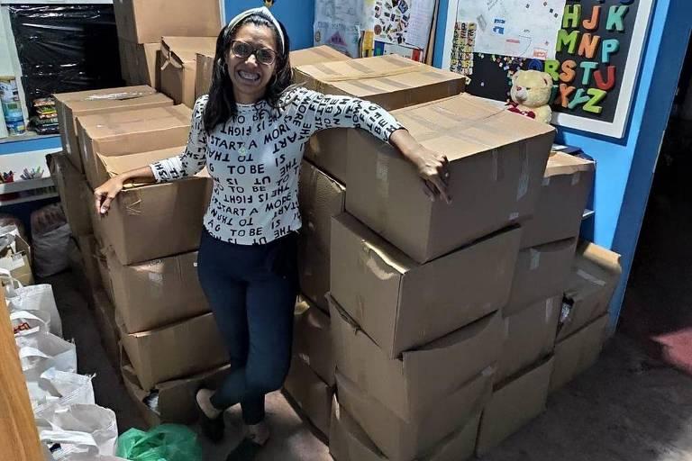Stella Maris Monteiro Moraes, 35, da ONG Anjos da Tia Stellinha, que distribuiu máscaras, alimentos e vale alimentação a populações vulneráveis no Rio de Janeiro