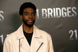 FILE PHOTO: Cast member Boseman poses at a photo call for the movie