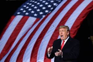 Trump holds rally on eve of twin runoffs in Georgia which will determine control of Senate