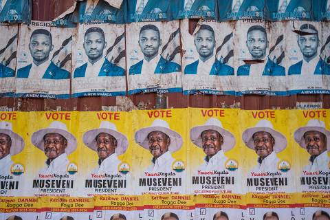 Posters of the two most popular candidates for Uganda's Presidential election, incumbent President Yoweri Museveni (yellow) and Robert Kyagulanyi, aka Bobi Wine, the pop star-turned-opposition leader, are seen along a street in Kampala, Uganda, on January 6, 2021. - Uganda gears up for presidential elections which is scheduled to take place on January 14, 2021, as President Yoweri Museveni seeks another term to continue his 35-year rule.poster of Uganda's President Yoweri Museveni who is running for his 6th presidential term. (Photo by SUMY SADURNI / AFP) ORG XMIT: STR