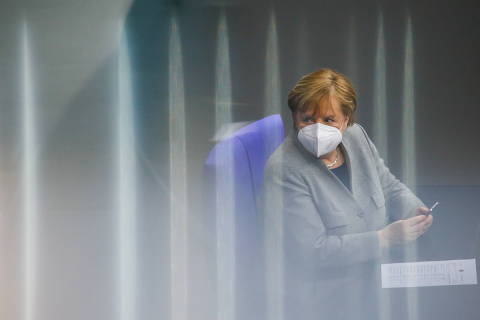 German Chancellor Angela Merkel attends a session at the lower house of parliament Bundestag on the start of the coronavirus disease (COVID-19) vaccinations, in Berlin, Germany, January 13, 2021. REUTERS/Michele Tantussi ORG XMIT: GDN
