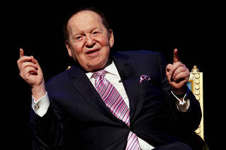 FILE PHOTO: Las Vegas Sands Corp Chairman and Chief Executive Sheldon Adelson speaks during a news conference on the opening of Parisian Macao in Macau