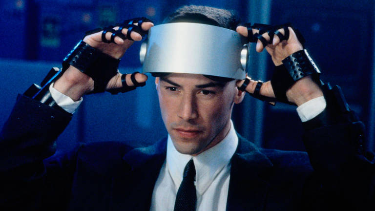 "Keanu Reeves em cena do filme ""Johnny Mnemonic, o Cyborg do Futuro"", de Robert Longo"