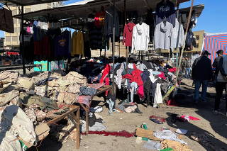 A view shows the site of a suicide attack in a central market in Baghdad