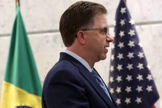 U.S. Ambassador Todd Chapman walks between flags during a meeting at Sao Paulo's Industries Federation in Sao Paulo
