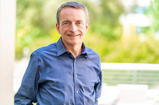 FILE PHOTO: VMware CEO Pat Gelsinger poses in an undated photo