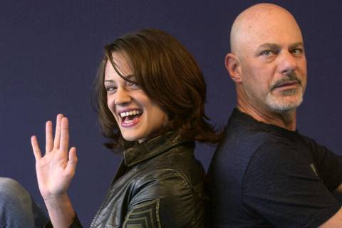 (FILES) In this file photo taken on September 07, 2002 Italian actress Asia Argento poses with US director Rob Cohen during the 28th American Film Festival of Deauville before the screening of Cohen's film