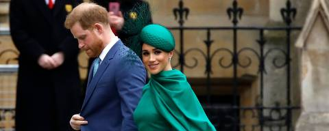 (FILES) In this file photo taken on March 09, 2020 Britain's Prince Harry, Duke of Sussex, (L) and Meghan, Duchess of Sussex arrive to attend the annual Commonwealth Service at Westminster Abbey in London on March 09, 2020. - Meghan Markle has revealed she suffered a miscarriage in July this year, writing in the New York Times on November 25, 2020 of the deep grief and loss she endured with her husband Prince Harry. (Photo by Tolga AKMEN / AFP)
