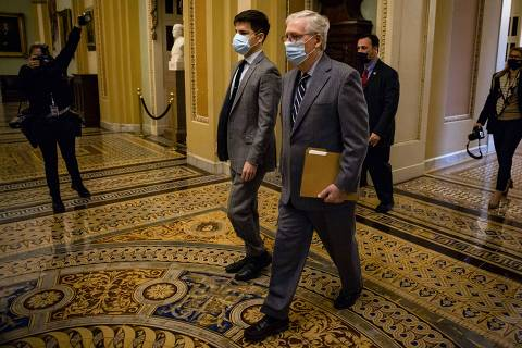 WASHINGTON, DC - JANUARY 26: Senate Minority Leader Mitch McConnell (R-KY) heads to the Senate floor before being called into session on January 26, 2021 in Washington, DC. Today senators will be sworn in as the jury for the second impeachment trial of former President Donald Trump. Senate President pro tempore Patrick Leahy (D-VT) will preside over the trial in place of Supreme Court Chief Justice John Roberts.   Samuel Corum/Getty Images/AFP == FOR NEWSPAPERS, INTERNET, TELCOS & TELEVISION USE ONLY ==