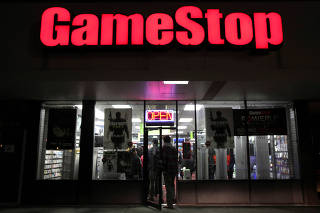 FILE PHOTO: People enter a GameStop store during