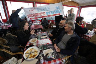 A restaurant in the French Riviera city of Nice opens for lunch in defiance of nationwide COVID-19 rules
