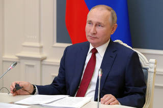 FILE PHOTO: Russia's President Putin attends a video conference during the World Economic Forum (WEF) of the Davos Agenda, in Moscow