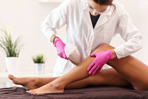 Picture of adult woman having laser hair removal in professional beauty salon