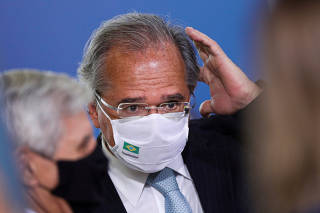 FILE PHOTO: Brazil's Economy Minister Paulo Guedes reacts before a ceremony at the Planalto Palace