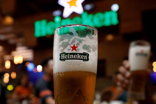 FILE PHOTO: Glasses of Heineken beer are seen at a restaurant in Hanoi