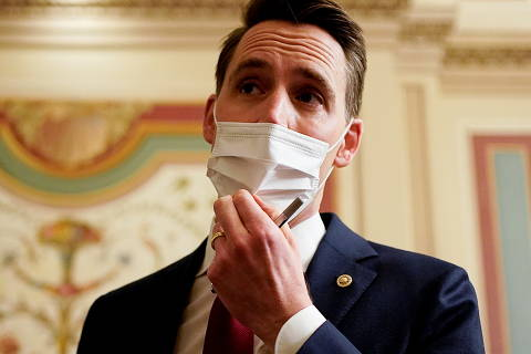 U.S. Senator Josh Hawley (R-MO) talks to reporters during a break in opening arguments in the impeachment trial of former U.S. President Donald Trump, on charges of inciting the deadly attack on the U.S. Capitol, on Capitol Hill in Washington, U.S., February 10, 2021. REUTERS/Joshua Roberts/Pool ORG XMIT: WAS118