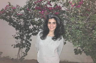 Women's rights activist Loujain al-Hathloul poses at home
