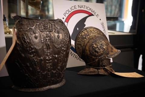 This picture taken on March 3, 2021, shows a breastplate and a ceremonial helmet during their official restitutions by the French Central Directorate of the Judicial Police (DCPJ) to the Louvre Museum, in Paris. - A breastplate and a ceremonial helmet, two