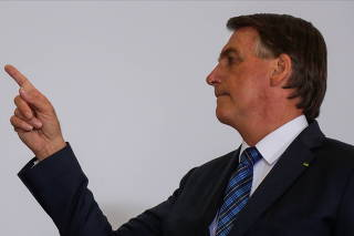 Brazil's President Jair Bolsonaro gestures during a ceremony to launch a program to help new mayors, at Planalto Palace in Brasilia