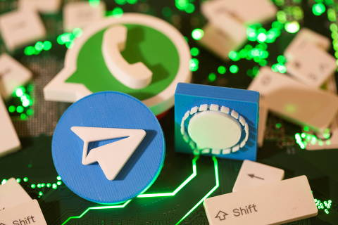 3D printed Telegram, Signal and WhatsApp logos and keyboard buttons are placed on a computer motherboard in this illustration taken January 21, 2021. REUTERS/Dado Ruvic/Illustration ORG XMIT: DAD023