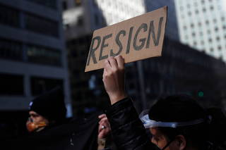 Demonstrators block 3rd avenue outside the New York Governor Andrew Cuomo's office calling for his resignation, in the Manhattan borough of New York