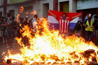 Paraguayans protest after opposition lawmakers lost a bid to impeach President Mario Abdo over the government's handling of the coronavirus pandemic, in Asuncion