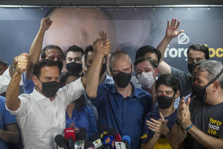Doria e Covas após reeleição do prefeito tucano em São Paulo