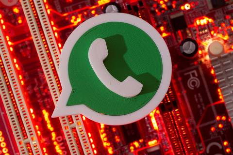 FILE PHOTO: A 3D printed Whatsapp logo is placed on a computer motherboard in this illustration taken January 21, 2021. REUTERS/Dado Ruvic/Illustration/File Photo ORG XMIT: FW1