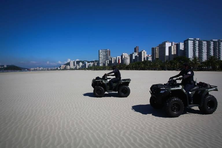 Primeiro dia de lockdown em Santos (SP) tem praias vazias, lojas fechadas e ciclistas nas ruas