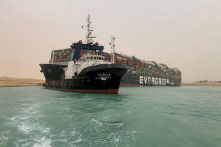 FILE PHOTO: Container ship runs aground in Suez Canal, blocks traffic