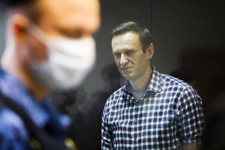 FILE PHOTO: Russian opposition politician Alexei Navalny attends a hearing hearing to consider an appeal against an earlier court decision to change his suspended sentence to a real prison term