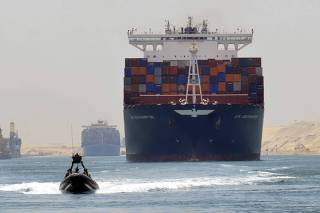 File photo of a cargo ship is seen crossing through the New Suez Canal, Egypt