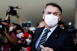 FILE PHOTO: Brazil's President Jair Bolsonaro is seen after a meeting with Brazil's Lower House Arthur Lira at the Planalto Palace, in Brasilia
