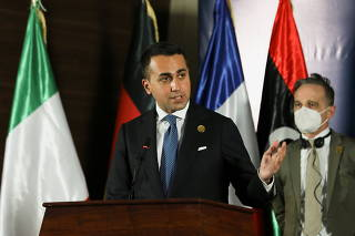Italian Foreign Minister Luigi Di Maio sepals as he delivers a joint statement with French Foreign Minister Jean-Yves Le Drian, German Foreign Minister Heiko Maas and Libyan Prime Minister Abdulhamid Dbeibeh, in Tripoli