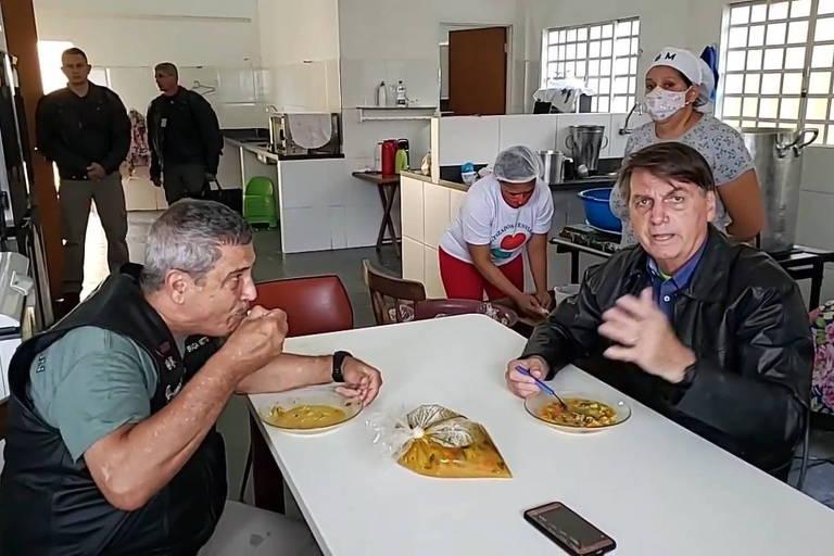 O presidente Jair Bolsonaro e o ministro da Defesa, Braga Netto